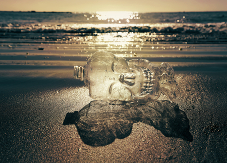 Plastic bottle on the beach. Plastic kills our marine creatures.