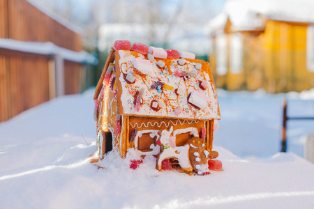 gingerbread house: Gingerbread house stands in the snow