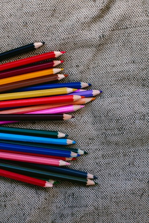 Colored pencils on grey background Stock Photo