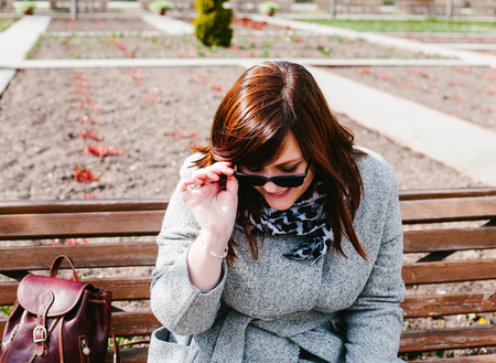suncare: Girl puts on sunglasses. Spring in Moscow Stock Photo
