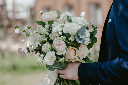 A man holds a wedding bouquet Stock Photo