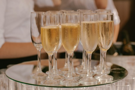 With sparkling champagne glasses on a tray Stock Photo