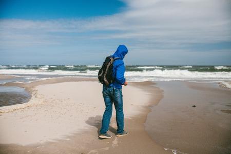 Man walks on the beach. The island of Texel, North Sea.