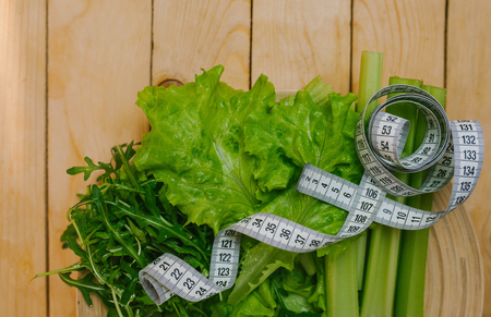 lettuce with measuring tape. Healthy Stock Photo