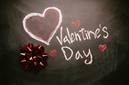 The inscription on the Valentine's day slate chalkboard, love Imagens