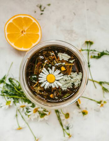 View from above on herbal tea in a cup with lemon, drink