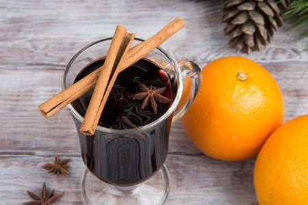 Cinnamon sticks on a glass of mulled wine. Christmas background