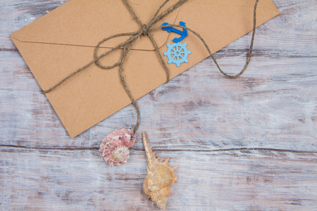 tied in: envelope tied with twine with ornaments in marine style - steering wheel, anchor, shells