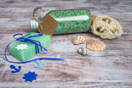 Set for spa treatments decorated in a marine style: sea mole, natural soaps, loofah, towel and themed ornaments Stock Photo