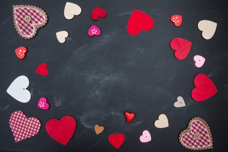 love declaration: Coloured bright hearts on a black chalk board. Space for your text. Valentines Day Stock Photo
