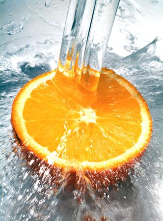 background waterfalls: Fresh orange jumping into water with a splash