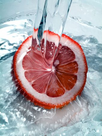 Fresh orange jumping into water with a splash Stock Photo - 767354