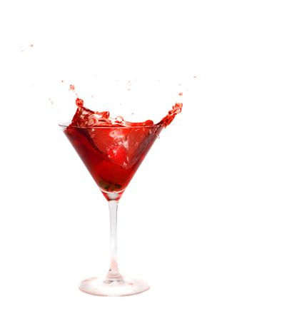 splashing strawberry into a cocktail glass