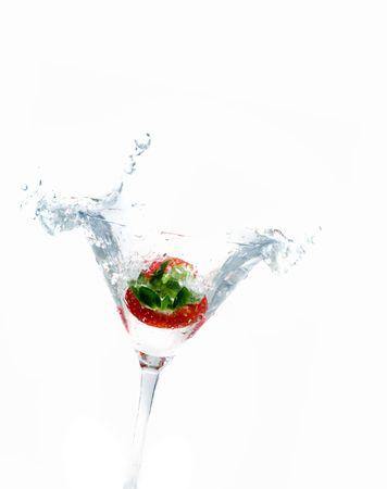 bartend: splashing strawberry into a martini glass Stock Photo