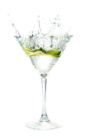 bartend: splashing Carambola into a martini glass Stock Photo