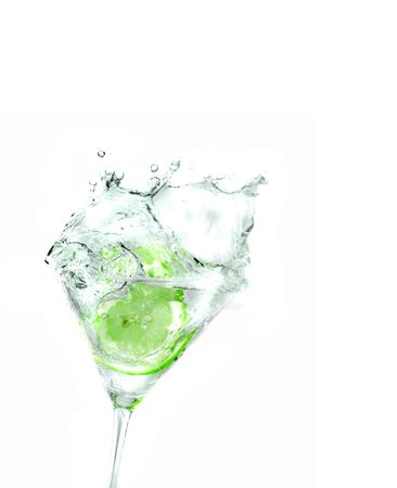 splashing llime into a martini glass