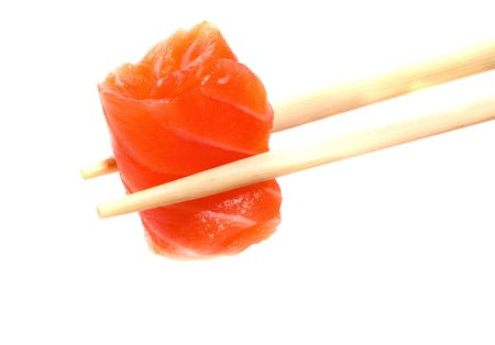 A piece of salmon fish meat in chopsticks photo