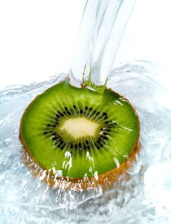 consume: Fresh kiwi jumping into water with a splash