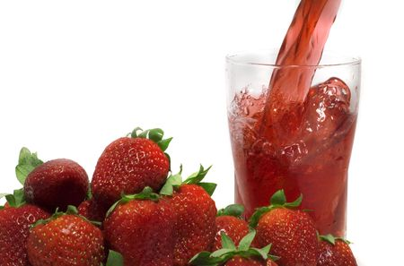 refreshed: pouring fresh strawberry juice  on a white background