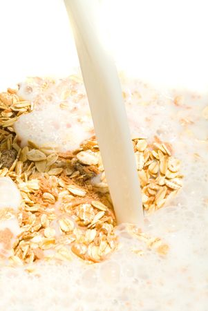 A delicious healthy bowl of muesli With milk  photo