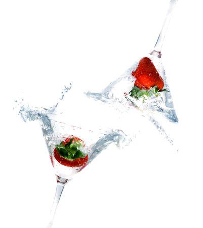 bartending: splashing strawberry into a cocktail glass