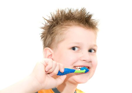 The boy cleaning teeth. Isolation on white. Stock Photo - 1018344
