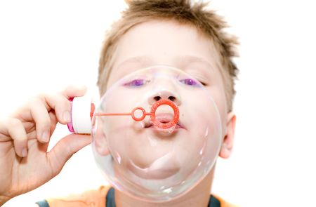 Boy blowing a bubble. Isolation on white. Stock Photo - 1018334