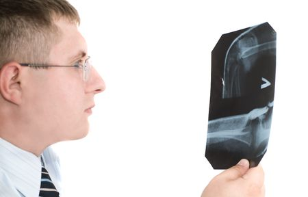 Doctor examining x-ray scans against white background Stock Photo - 1018014