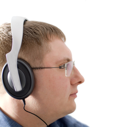enraptured: The man in headphones. Isolation on white Stock Photo