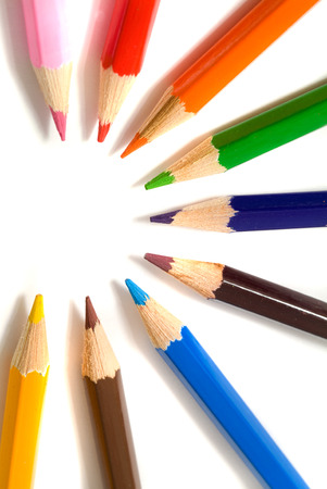 coloured pencils with shadow on white background Stock Photo