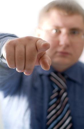 businessman waiting call: businessman, indicating a finger