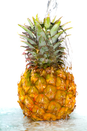 Pineapple with poured water. Isolation on white Stock Photo - 1658035
