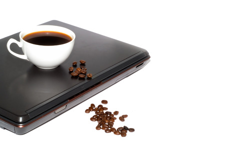 Cup of coffee on a computer. Isolation on white Stock Photo - 1657940