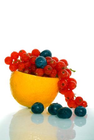 Orange with a berry. Isolation on white photo