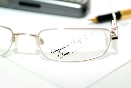 Small print through a blurry pair of glasses photo