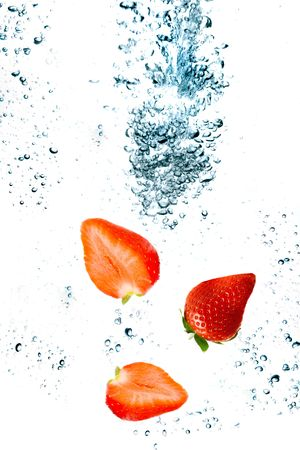 Strawberry are falling in water with a big splash  Stock Photo
