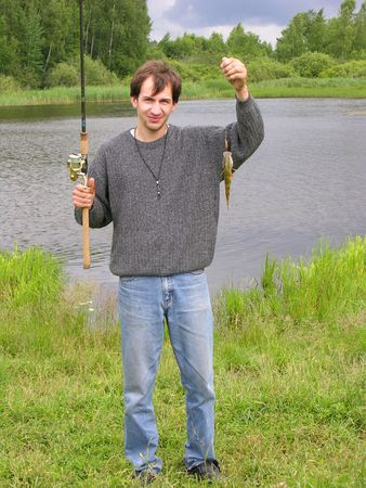 waders: man the fisherman on a background of a nature. Stock Photo