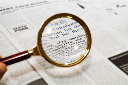 classifieds: Magnifying glass highlighting the word