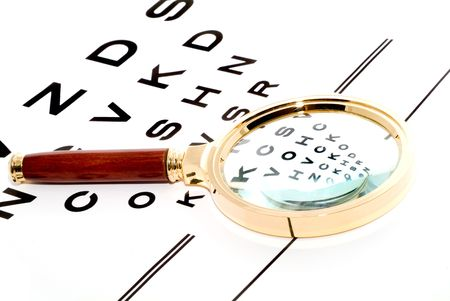 chart through a magnifier. Isolation. Stock Photo