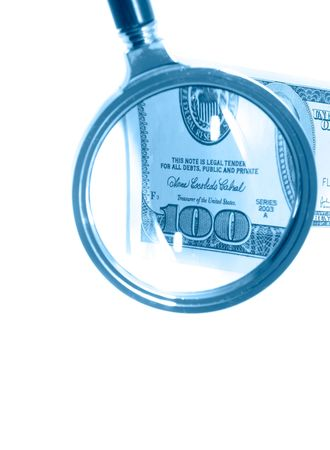 Banknotes through a magnifier. Isolation. photo
