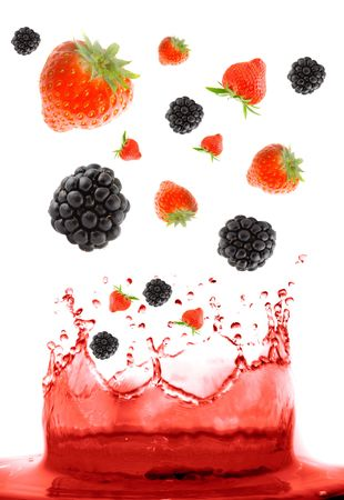 refreshed: berry falling in juice. Isolation.  Stock Photo