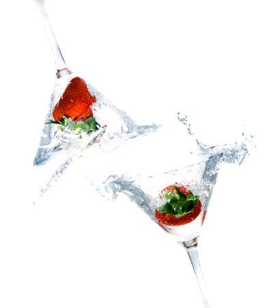 bartend: splashing strawberry into a cocktail glass  Stock Photo
