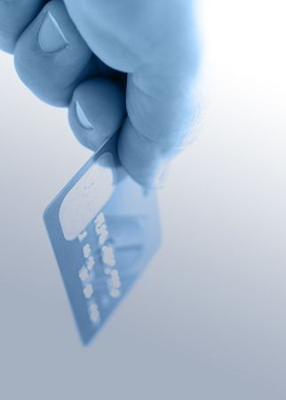 Hand holding credit cards. Small DOF Stock Photo - 2684841