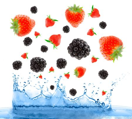 Berries falling in water. Isolation on the white photo