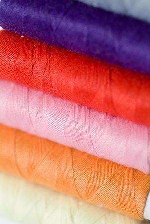 needlewoman: Multi-coloured textile a thread  Stock Photo