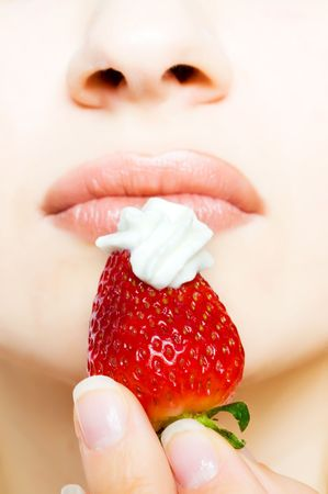 The girl with a strawberryn photo