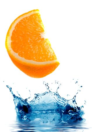 Fresh orange jumping into water with a splash photo