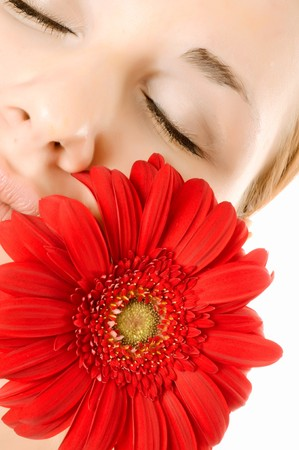 Beautiful young woman with gerber flower  photo