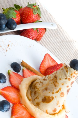 pancakes with syrup and berries photo