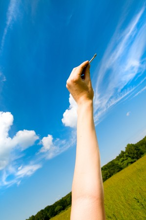 hand holding keys, blue skies in the background Stock Photo - 4065052